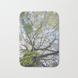 Centenary oak with the trunk covered in moss and green plants Bath Mat