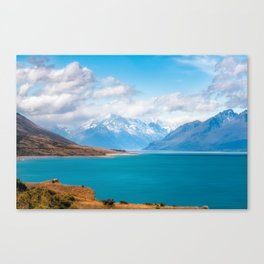 Blue waters of Lake Pukaki with snow-capped Mount Cook in the background in New Zealand Canvas Print