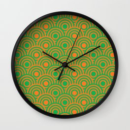 op art pattern retro circles in green and orange Wall Clock