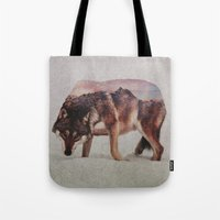 wolf Tote Bags featuring Wolf by Andreas Lie