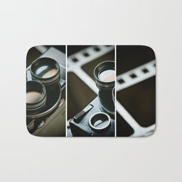 Old retro movie camera on background film Bath Mat