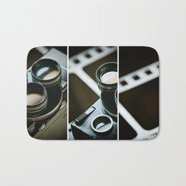 Old retro movie camera on background film Bath Mat