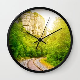 Railroad track diminishing perspective in forest along the cliff Wall Clock