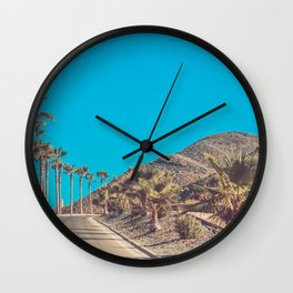 Andalusia street with palm trees at sunset. Retro toned Wall Clock