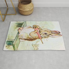 Peter Rabbit eating his carrot by Beatrix Potter Rug