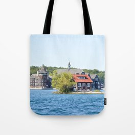 One Island with a small house in Thousand Islands Region in summer in Kingston, Ontario, Canada Tote Bag