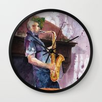 saxophone Wall Clocks featuring Playing saxophone by aurora villaviejas