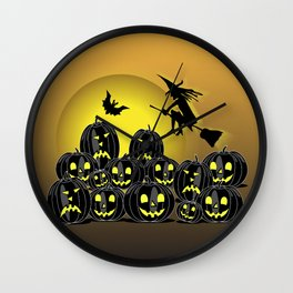 Pumpkins and witch in front of a full moon Wall Clock
