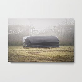Square Black Silage Bale on a Foggy Misty Evening. Metal Print