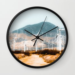 Wind turbine in the desert with mountain background at Kern County California USA Wall Clock
