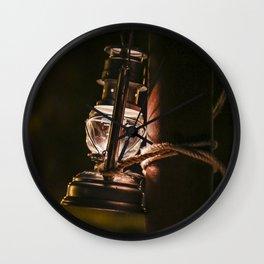 Pretty old oil lamp lantern in the dark Wall Clock
