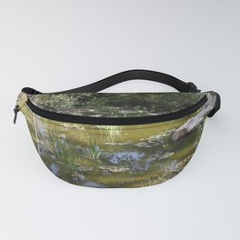 Pond with sky reflection Fanny Pack