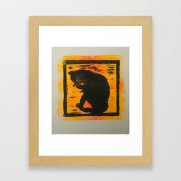 Cat sitting & licking silhouette, Lino print Framed Art Print