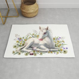 Baby unicorn lies in flowers Rug