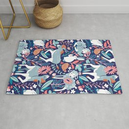 Spring Joy // navy blue background pale blue lambs and donkeys coral and teal garden Rug