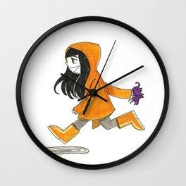 Running with my rain coat Wall Clock