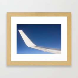 Airplane Wingtip on a blue sky Framed Art Print