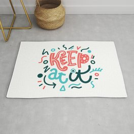 Keep at it.  Colourful lettering. Rug