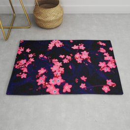 fluorescent forget-me-nots Rug