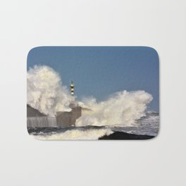Stormy wave over lighthouse Bath Mat