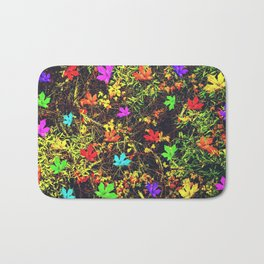 maple leaf in blue red green yellow pink orange with green creepers plants background Bath Mat