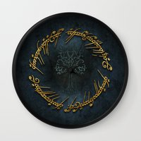lord of the rings Wall Clocks featuring The Lord Of The Rings Logo by Janismarika
