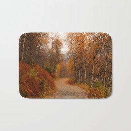 Winding country road in a fall forest Bath Mat