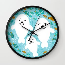 happy family of white seals and fish on a blue background. Wall Clock
