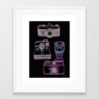 cameras Framed Art Prints featuring Cameras by Sara Wilson