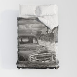 Black and White of Rusted International Harvester Pickup Truck behind wooden fence with Red Barn in Comforters