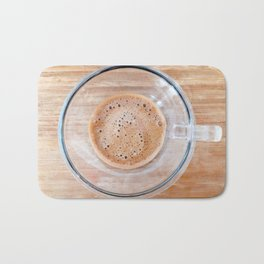 Transparent cup of coffee on a cutting board Bath Mat