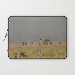 Bird perched after the rain at sunset Laptop Sleeve
