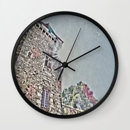 Tower under sun Wall Clock