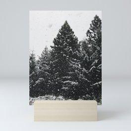 Snowy pine trees in Bariloche Mini Art Print