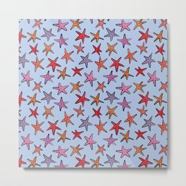 Starfishes in clear water Metal Print