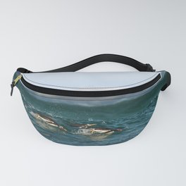 Penguins diving in the ocean Fanny Pack