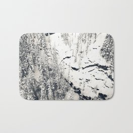 Snow on Textures of Pine Trees and Cliffs Bath Mat