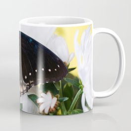 Tropical butterfly sitting on the white flower over Coffee Mug