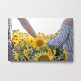 Couple holding hands in a sunflower field Metal Print