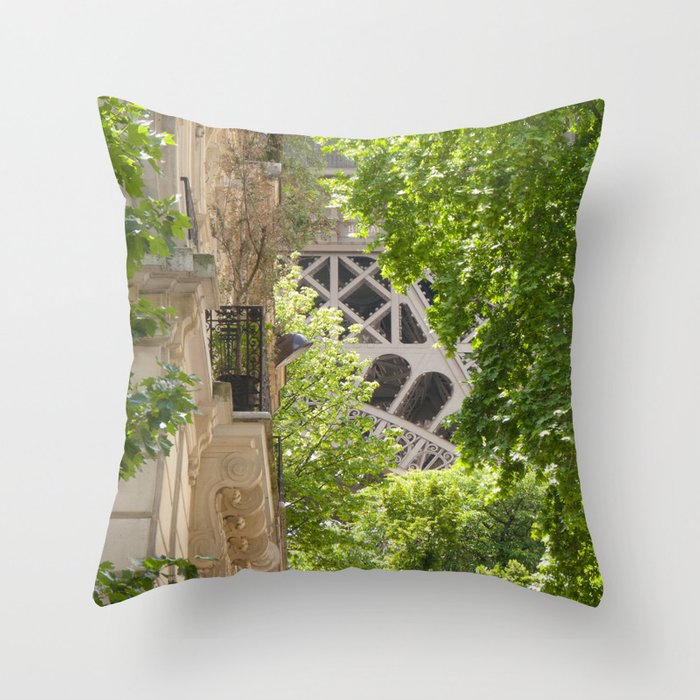 Eiffel tower in the street Throw Pillow