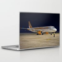 airplane Laptop & iPad Skins featuring Airplane by cjsphotos