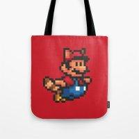 mario bros Tote Bags featuring Pixelated Super Mario Bros - Mario by Katadd
