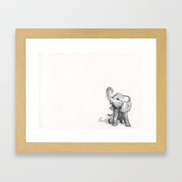 tiny elephant sitting in the corner Framed Art Print