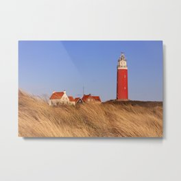 Lighthouse on Texel island in The Netherlands in morning light Metal Print