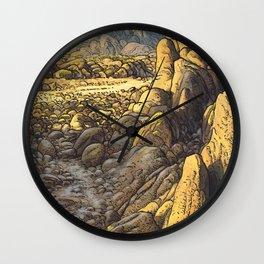 Rocky desert at sunset Wall Clock