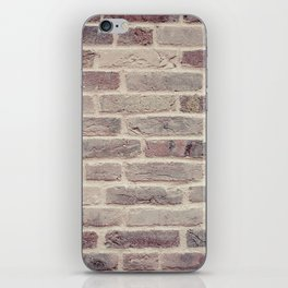 Wall built with bricks of various earth tones iPhone Skin