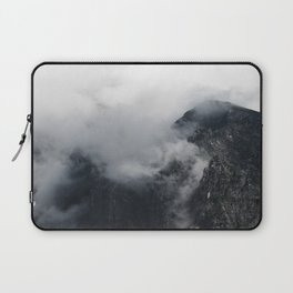 White clouds over the dark rocky mountains Laptop Sleeve