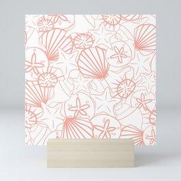 Coral pink seashells on white Mini Art Print