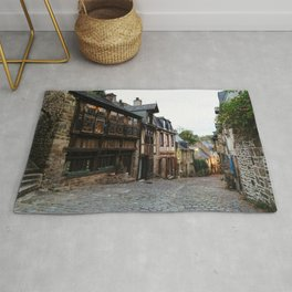 Old street in the town of Dinan at dusk Rug