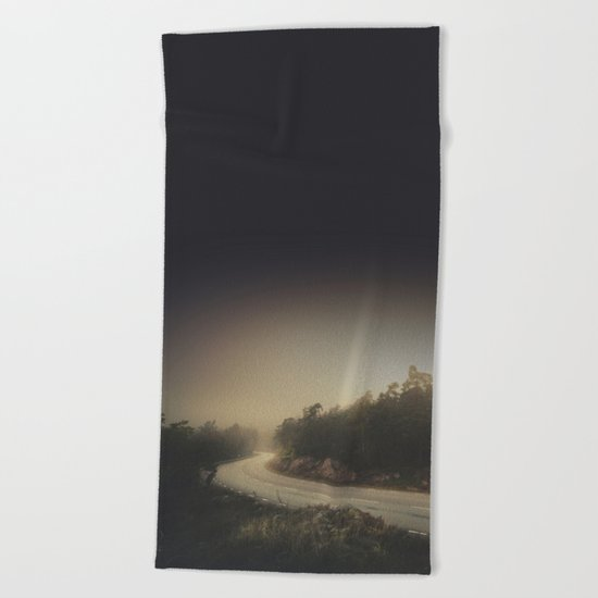 The roads we travel Beach Towel